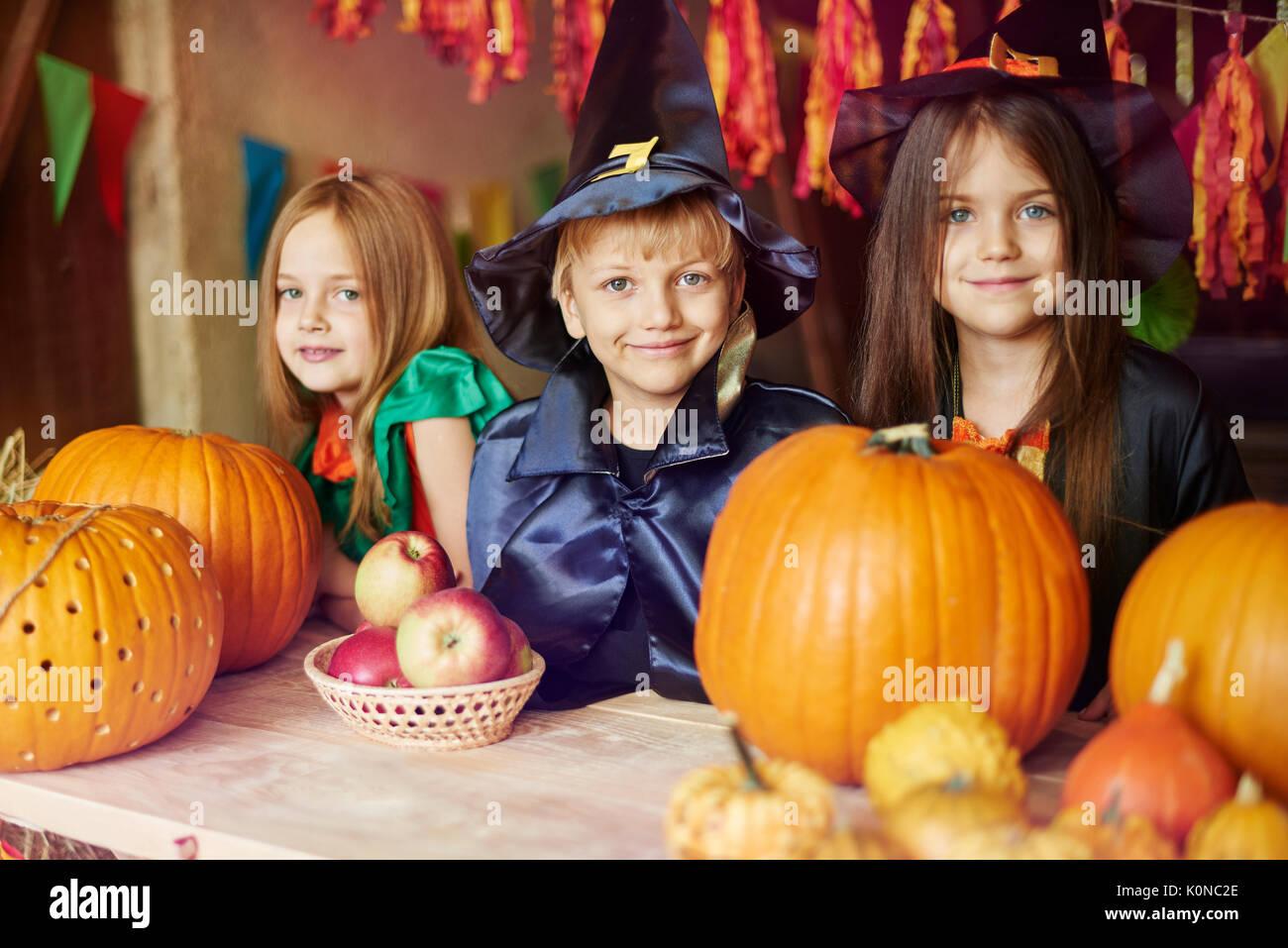 Portrait of children dressed in Halloween costumes - Stock Image