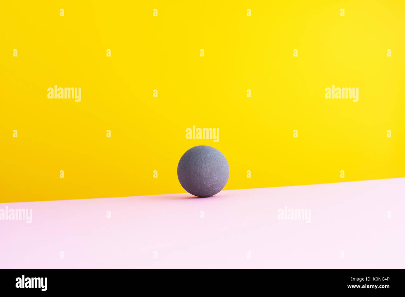 Sphere against yellow background, 3D Rendering - Stock Image