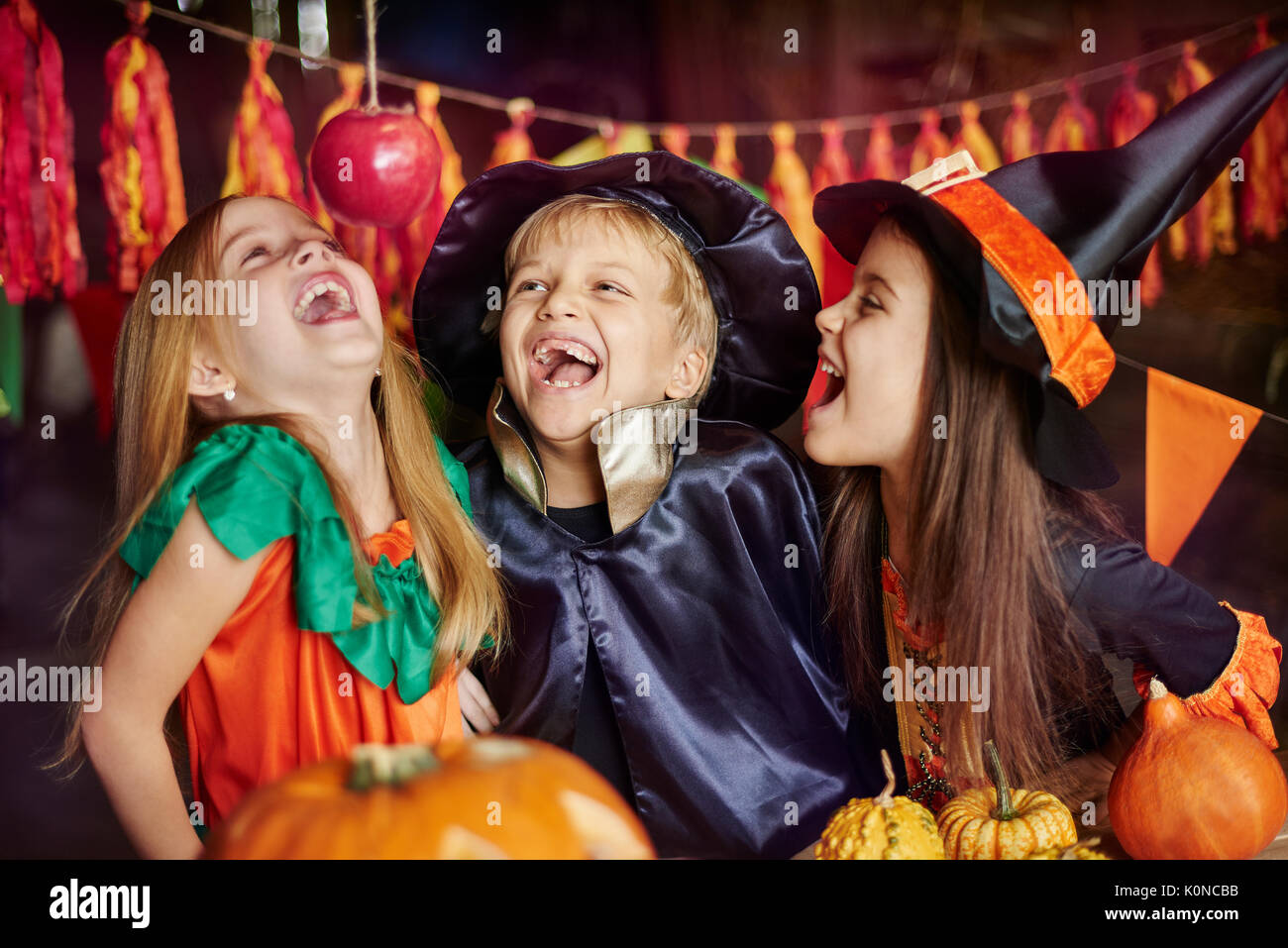 Competition of who will catch the apple as first - Stock Image