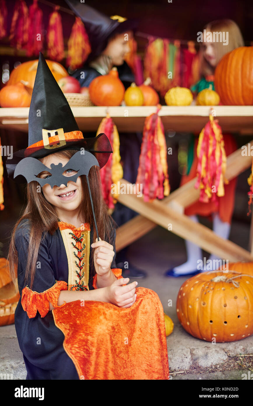Girl posing with a bat mask - Stock Image