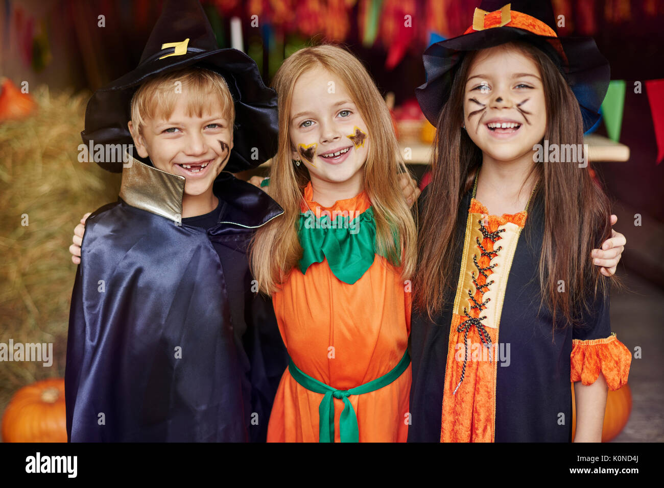 Cheerful children with Halloween face paint - Stock Image