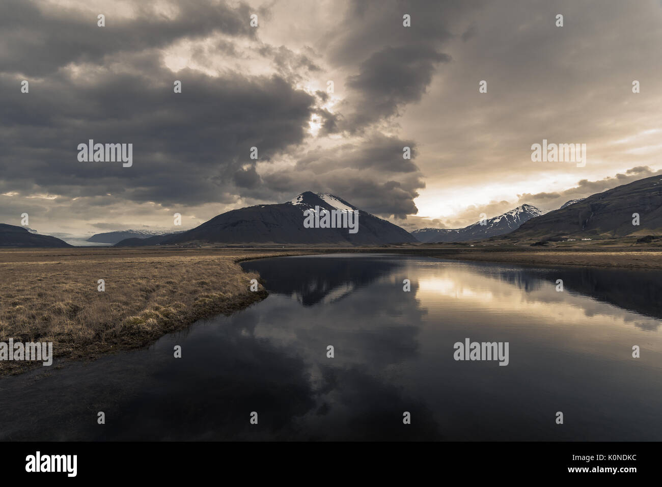 Beautiful sunset with reflection near Hoffell in Southeast Iceland - Stock Image
