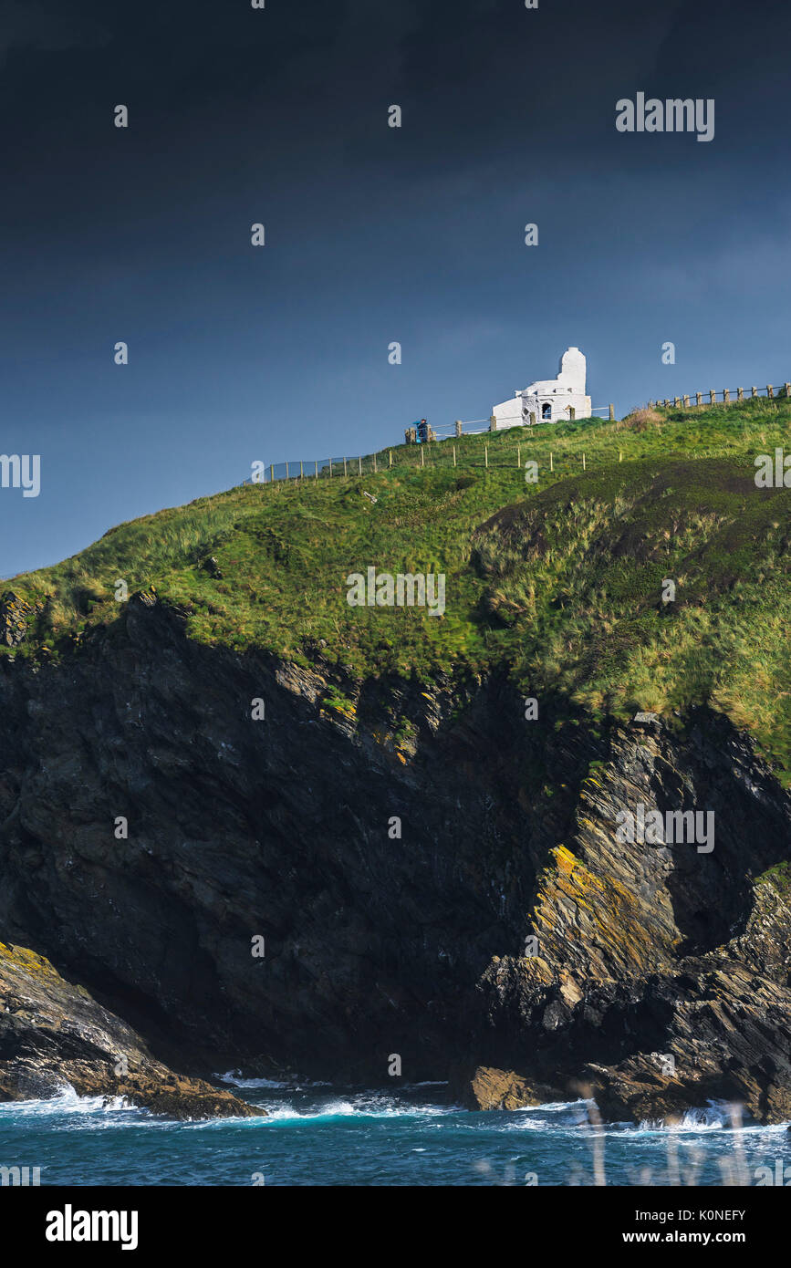 The well known landmark the Huers Hut on top of cliffs on the coast at Newquay in Cornwall. - Stock Image