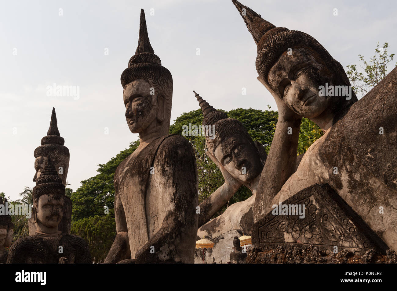 Numerous Buddha sculptures in Xieng Khuan, known as Buddha Park, outside Vientiane, Laos. - Stock Image