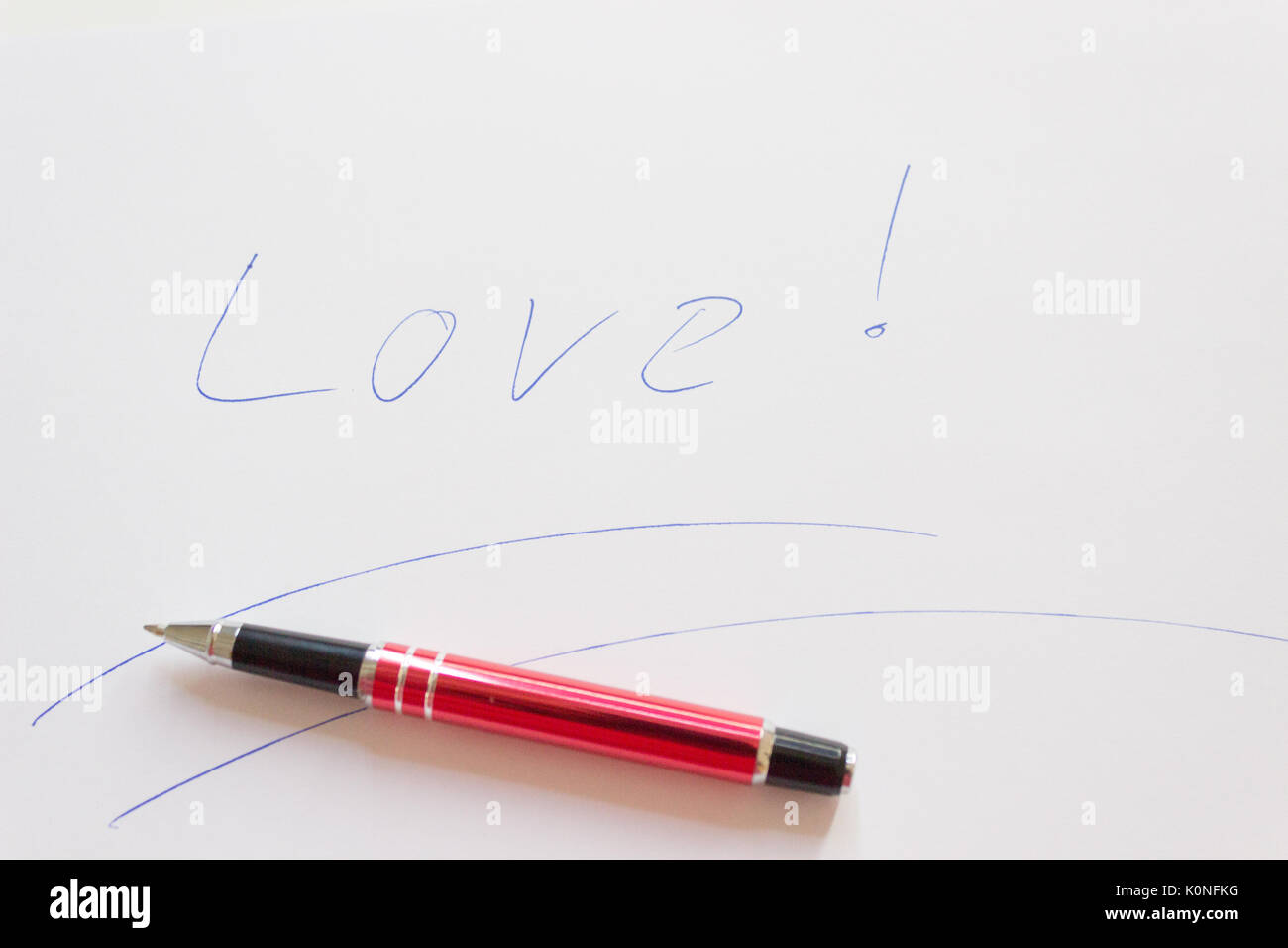 love letter writing essentials with red pen. - Stock Image