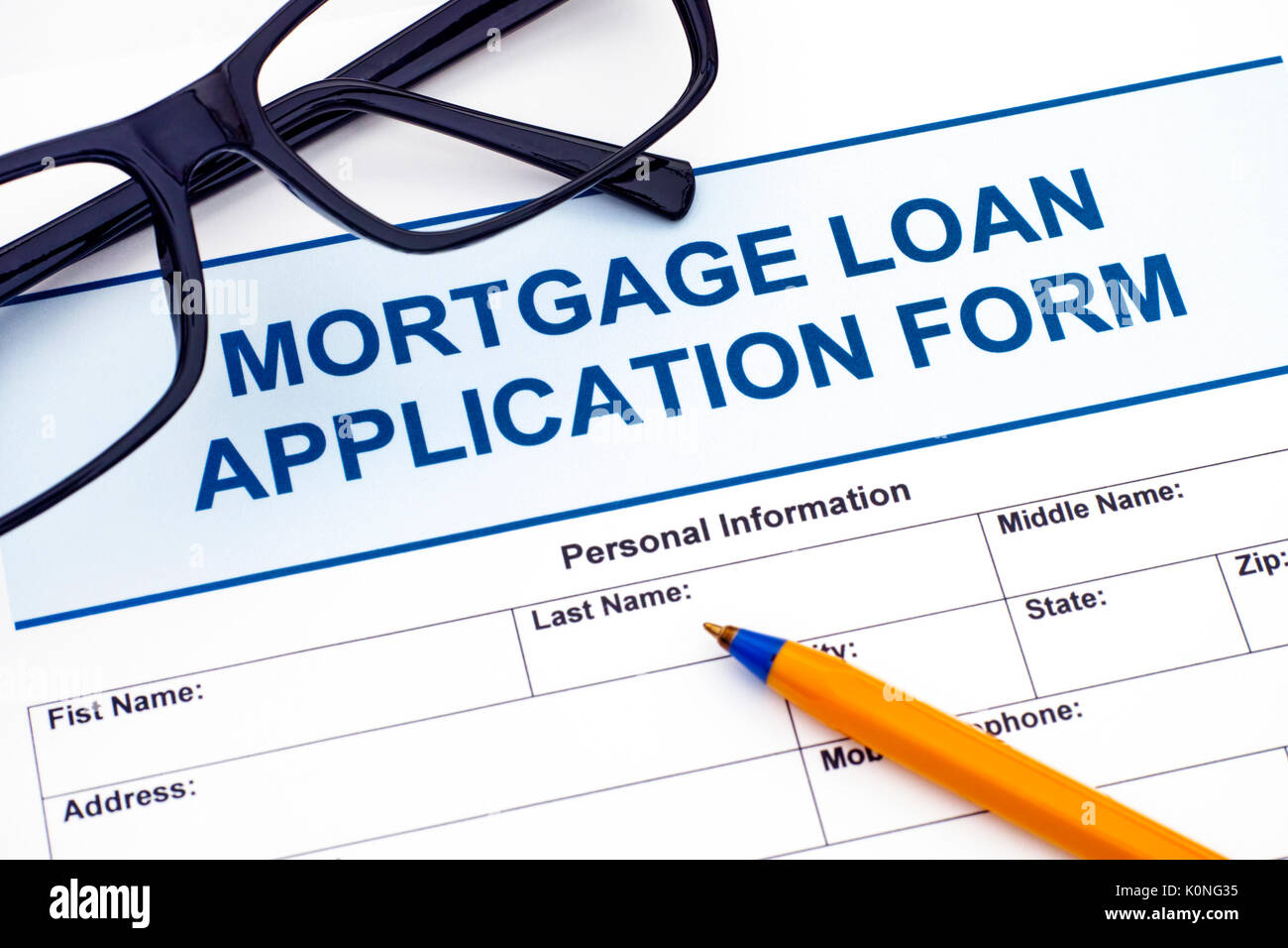 Mortgage Loan application form with ballpoint pen and glasses Stock Photo