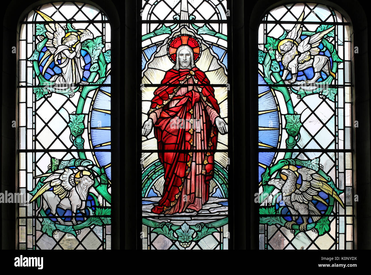 Stained Glass Window depicting Christ with Four Beasts of the Apocalypse - Stock Image