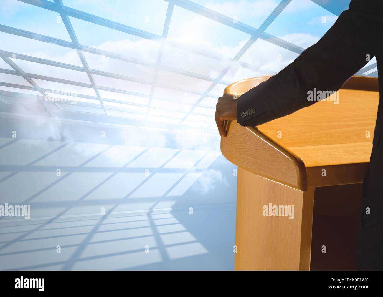 Digital composite of Businessman on podium speaking at conference with windows - Stock Image