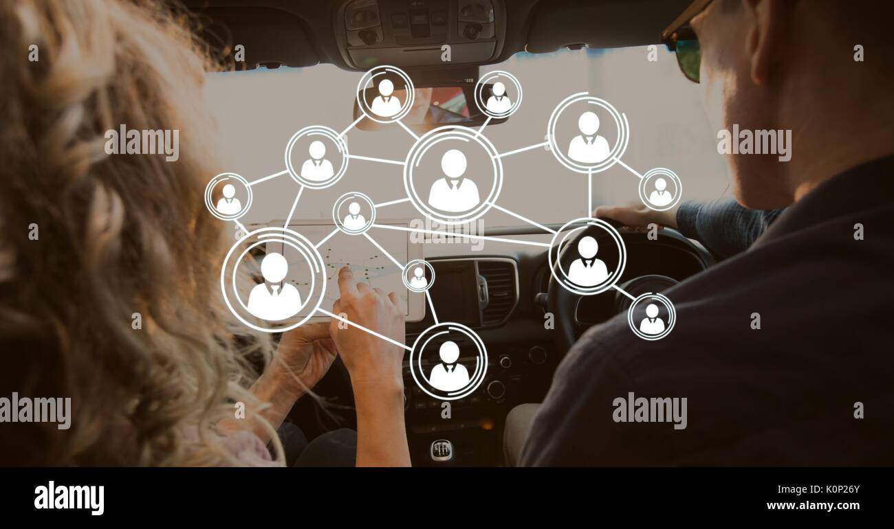 Digital composite of Interface against couple in the car Stock Photo