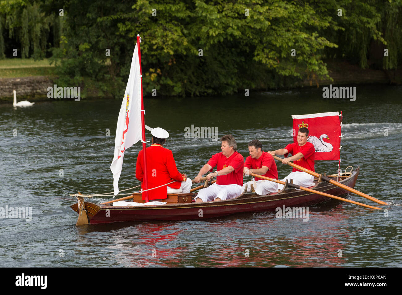 Eton, UK. 18th July, 2017. The Queen's Swan Marker, David Barber MVO, departs with Swan Uppers from Eton Bridge during Swan Upping. Swan Upping is an  - Stock Image