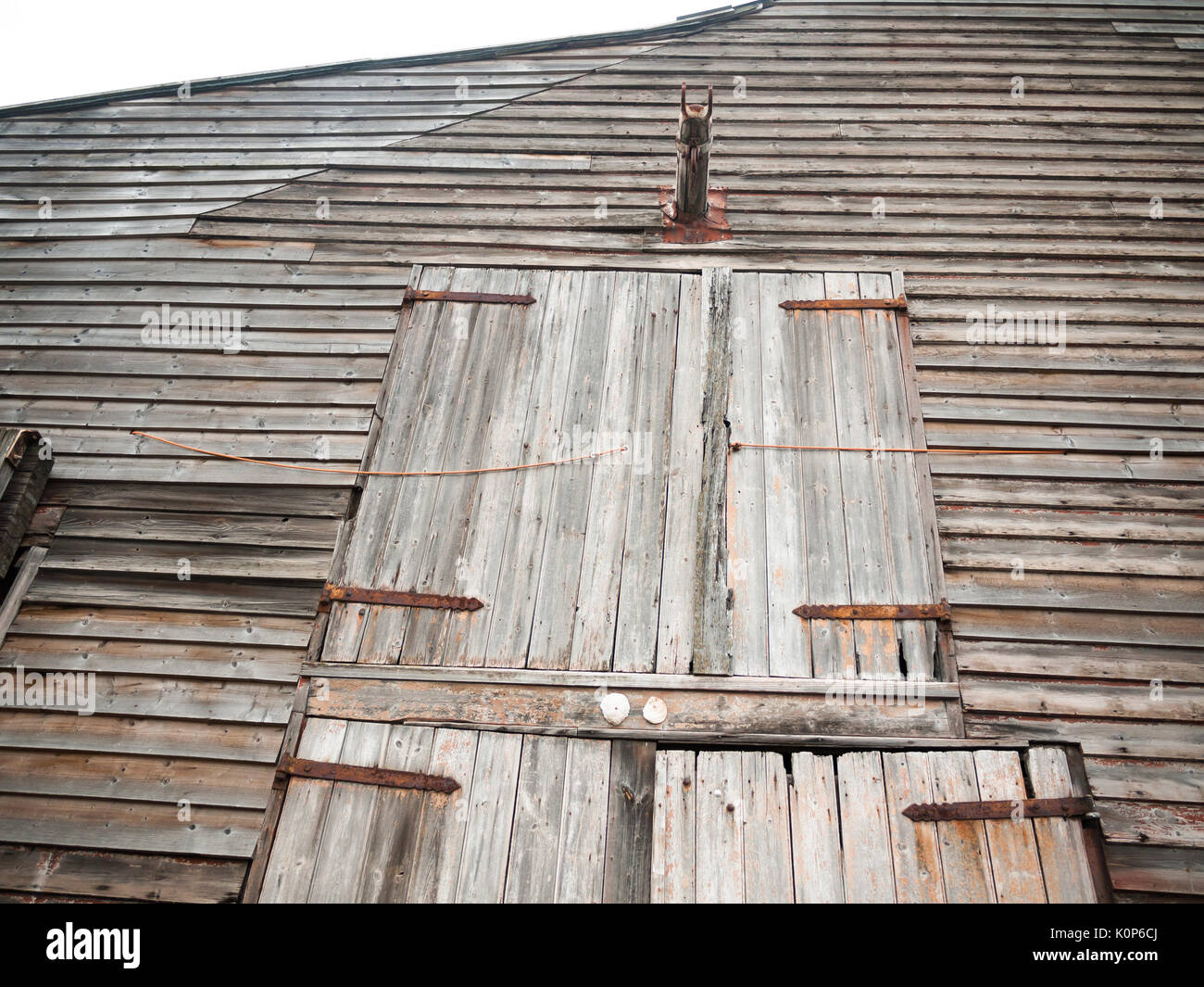 front of wooden old house rural shipbuilding yard special rustic; England; UK - Stock Image
