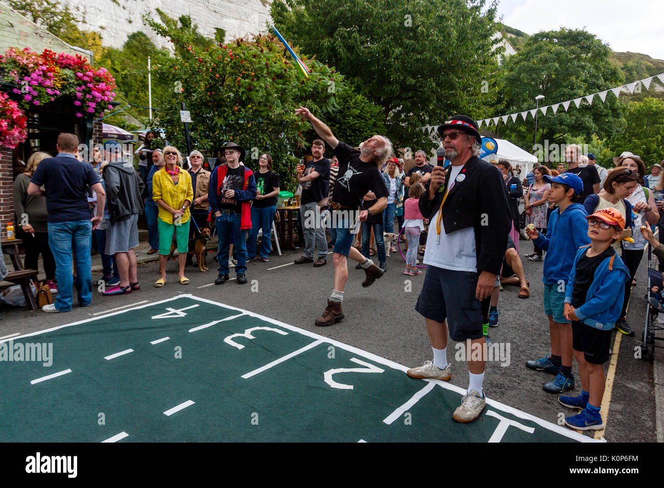 Throwing The 'Javelin' Contest At The Annual South Street Sports Day and Dog Show, Lewes, East Sussex, UK - Stock Image