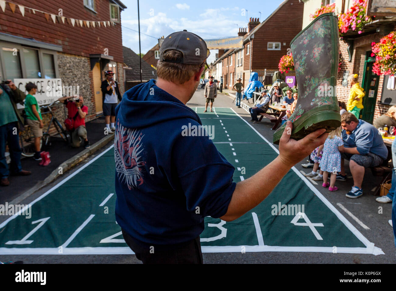 Local People Take Part In A 'Welly Throwing' Competition At The Annual South Street Sports Day and Dog Show, Lewes, Stock Photo