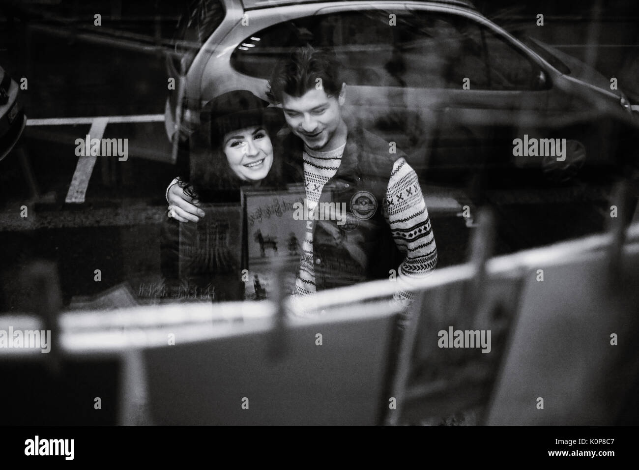 Young couple going window shopping in pre-christmas period - Stock Image