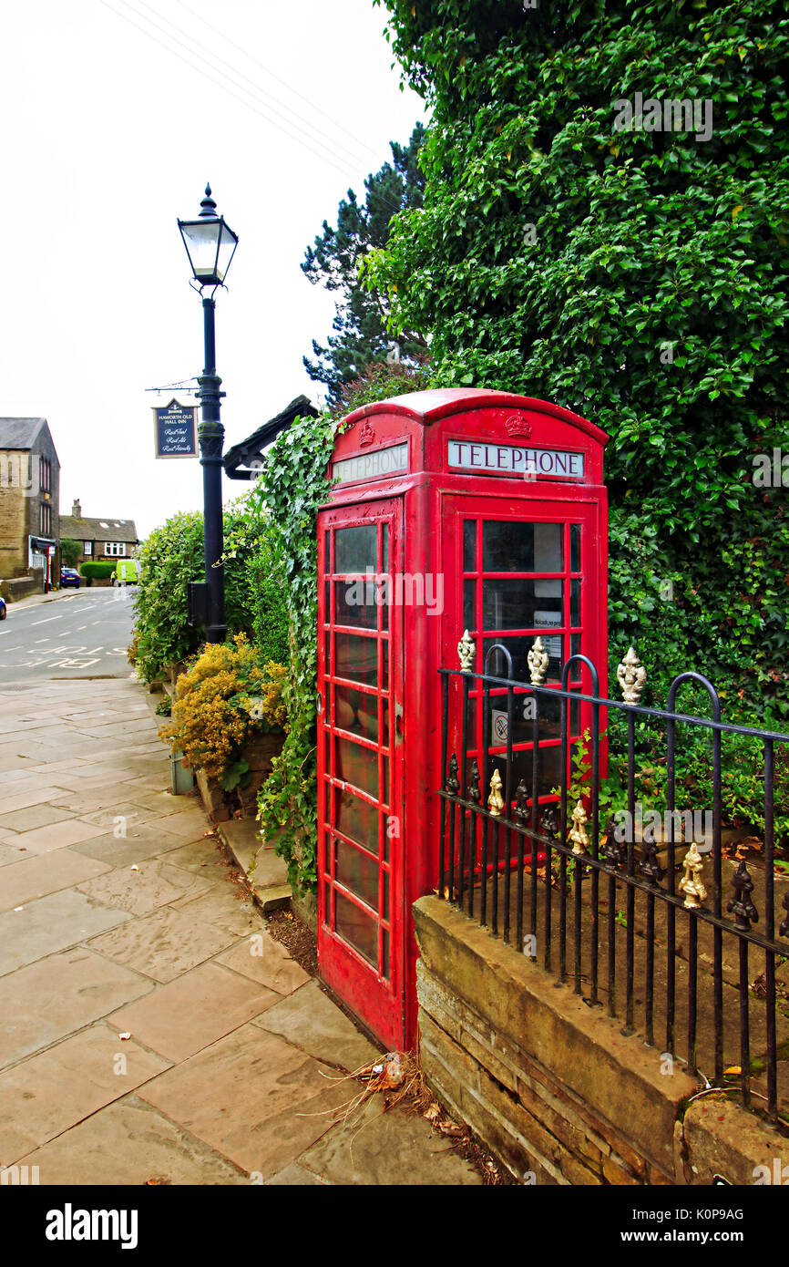 Old Fashioned red phone box on Main Street in the historic village of Haworth, West Yorkshire, England, UK. - Stock Image
