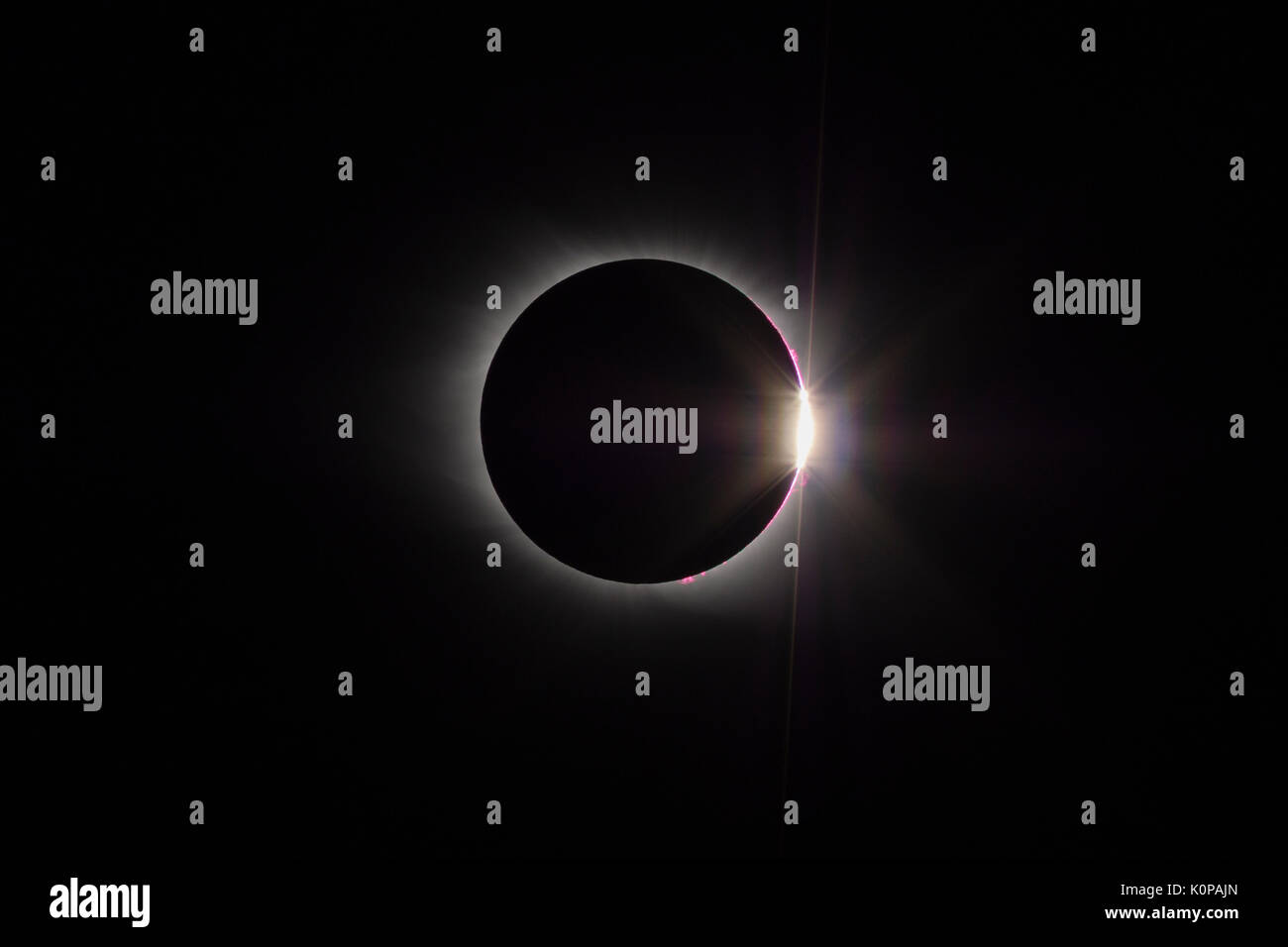The Sun's corona and the diamond ring effect are visible at the end of the total eclipse phase of the Great American Eclipse on August 21, 2017. - Stock Image