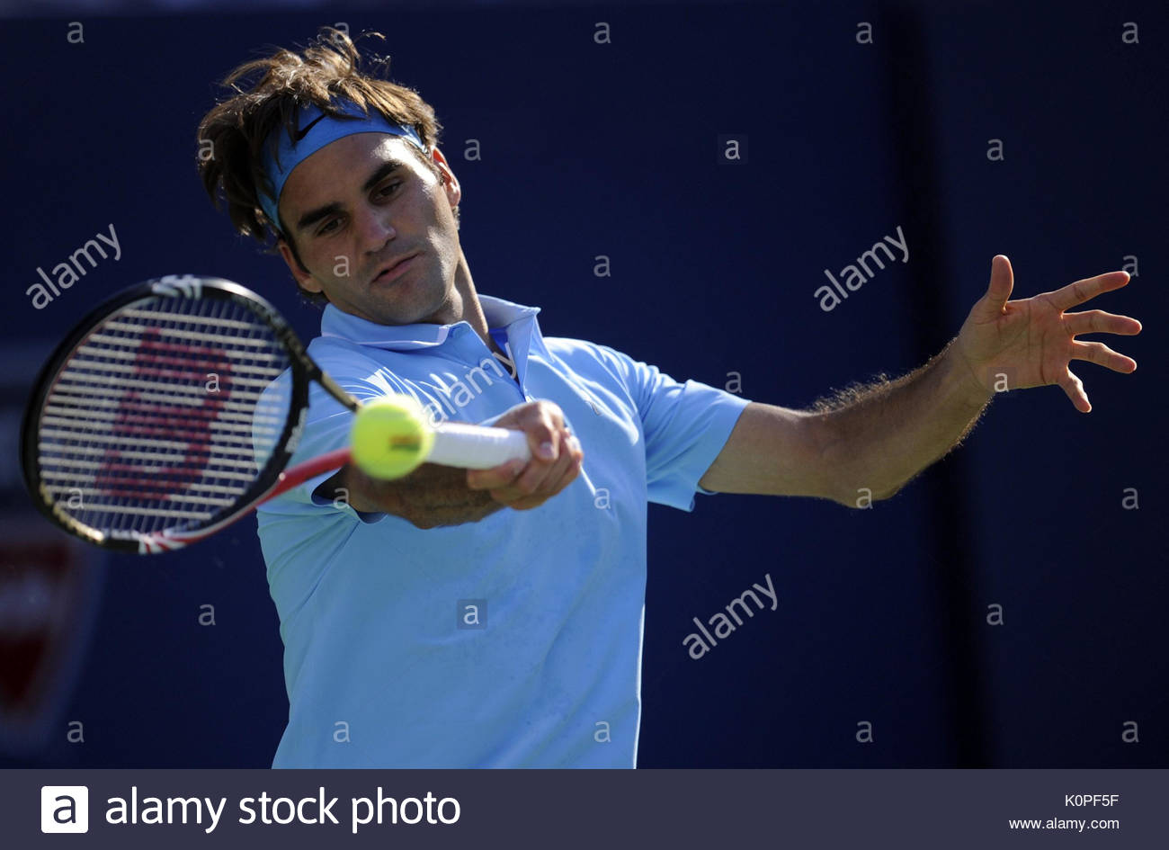 File photo dated 11-09-2010 of Switzerland's Roger Federer in action against Serbia's Novak Djokovic during day thirteen of the US Open - Stock Image