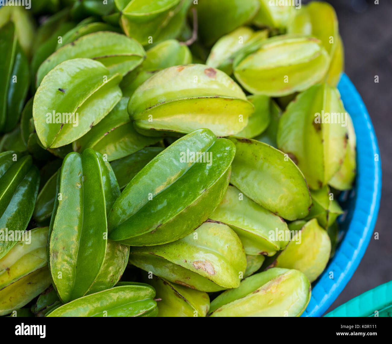 Close-up of star fruits or Carambola fruits was managed for sale in the Asian market. - Stock Image