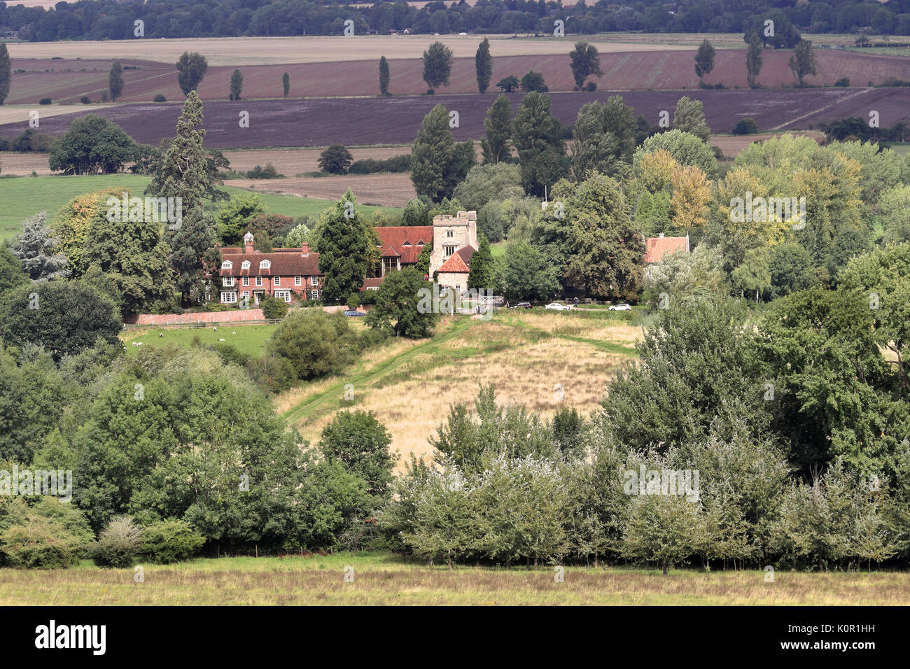 A Landscape in Rural Oxfordshire with fields and meadows and Hamlet of Little Wittenham - Stock Image