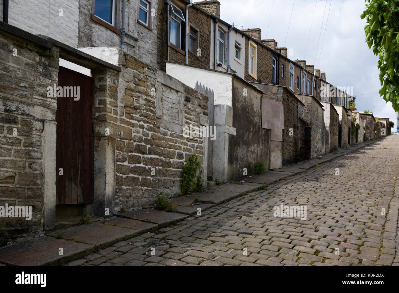 Back lane of Basil Street, Colne, Lancs, England, UK - Stock Image