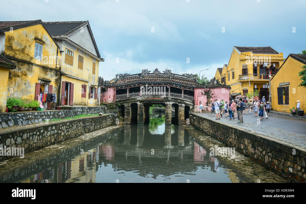 Hoi An, Vietnam - Nov 28, 2015. People visit the Historic Japanese Bridge (Chua Cau) in Hoi An Ancient Town, Vietnam. Hoi An is Vietnam most atmospher - Stock Image