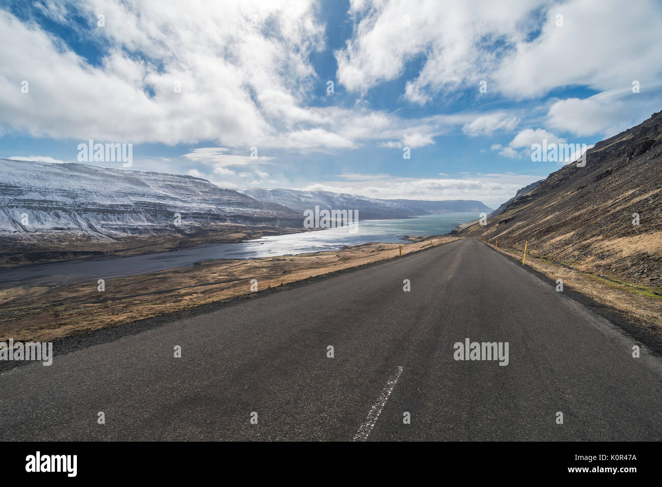 Looking down the road at dramatic scenery, isolation, Kollafjordur, Westfjords, Iceland - Stock Image