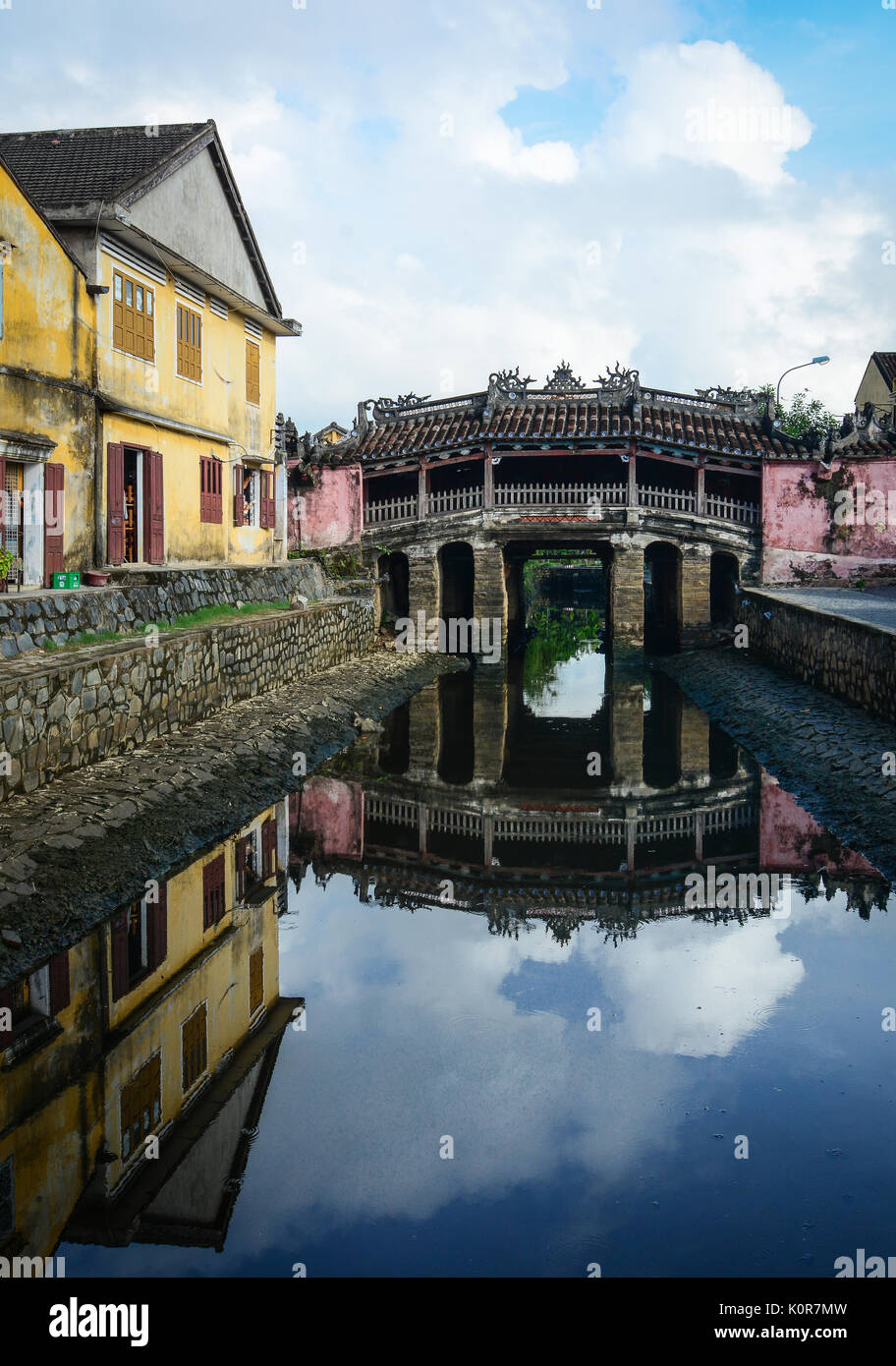 Reflection of the Japanese Bridge Pagoda (Chua Cau) in Hoi An, Vietnam. Ancient and peaceful, Hoi An is one of the most popular destinations in Vietna - Stock Image