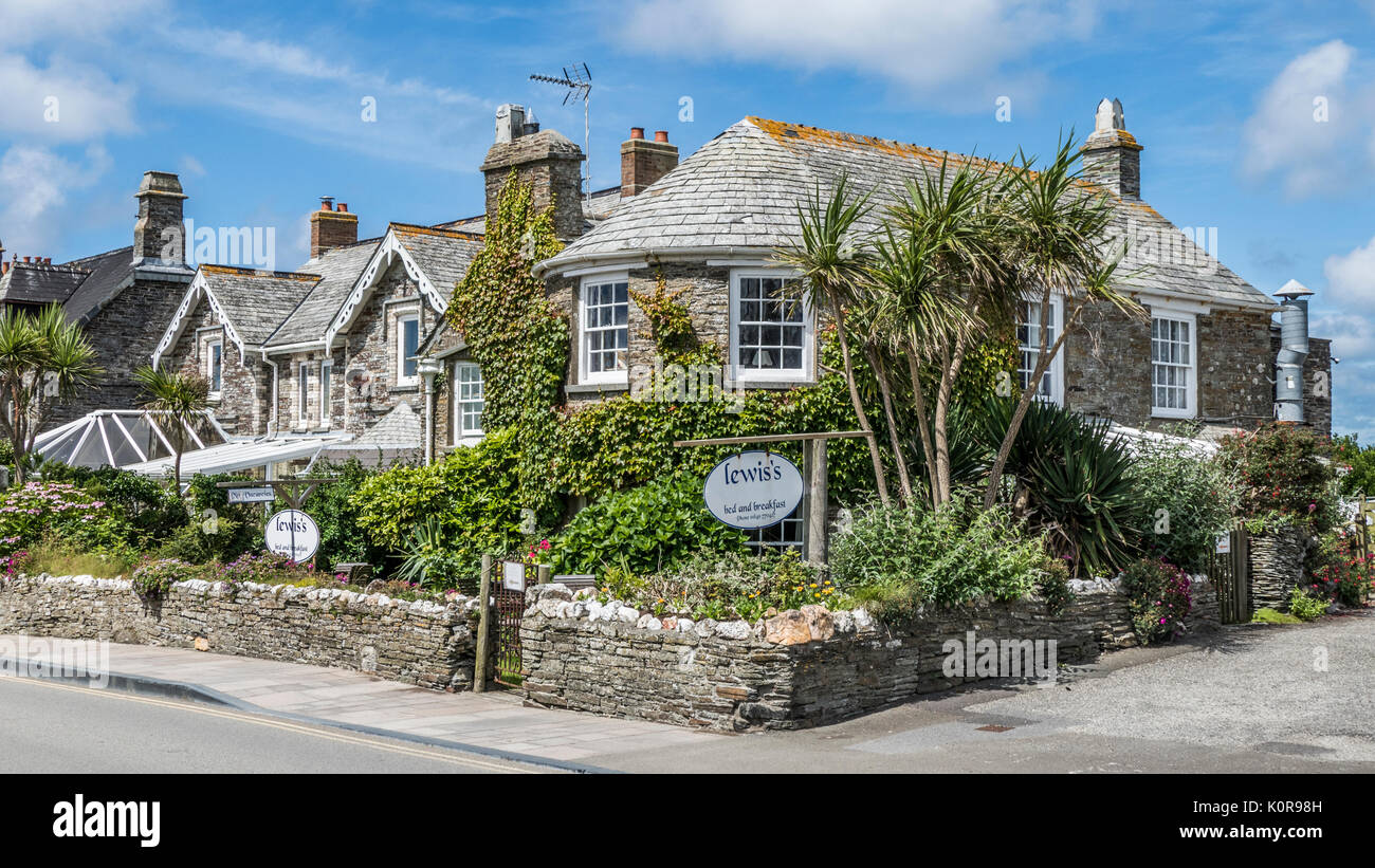 A beautiful 16th century stone corner house - Lewis's bed and breakfast, in the small tourist town of Tintagel, Cornwall, England, UK. - Stock Image