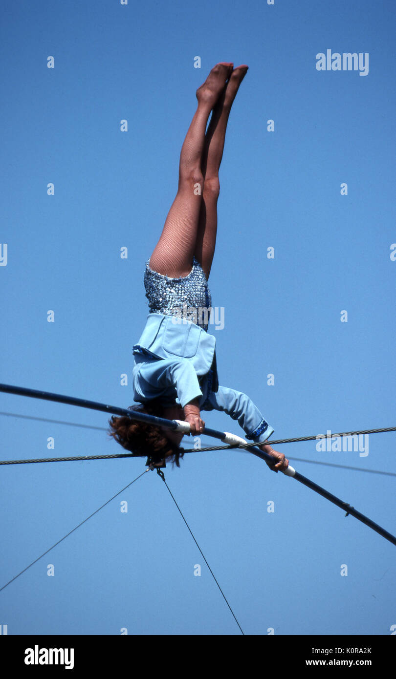 Circus performer on the high wire Long Island New York - Stock Image