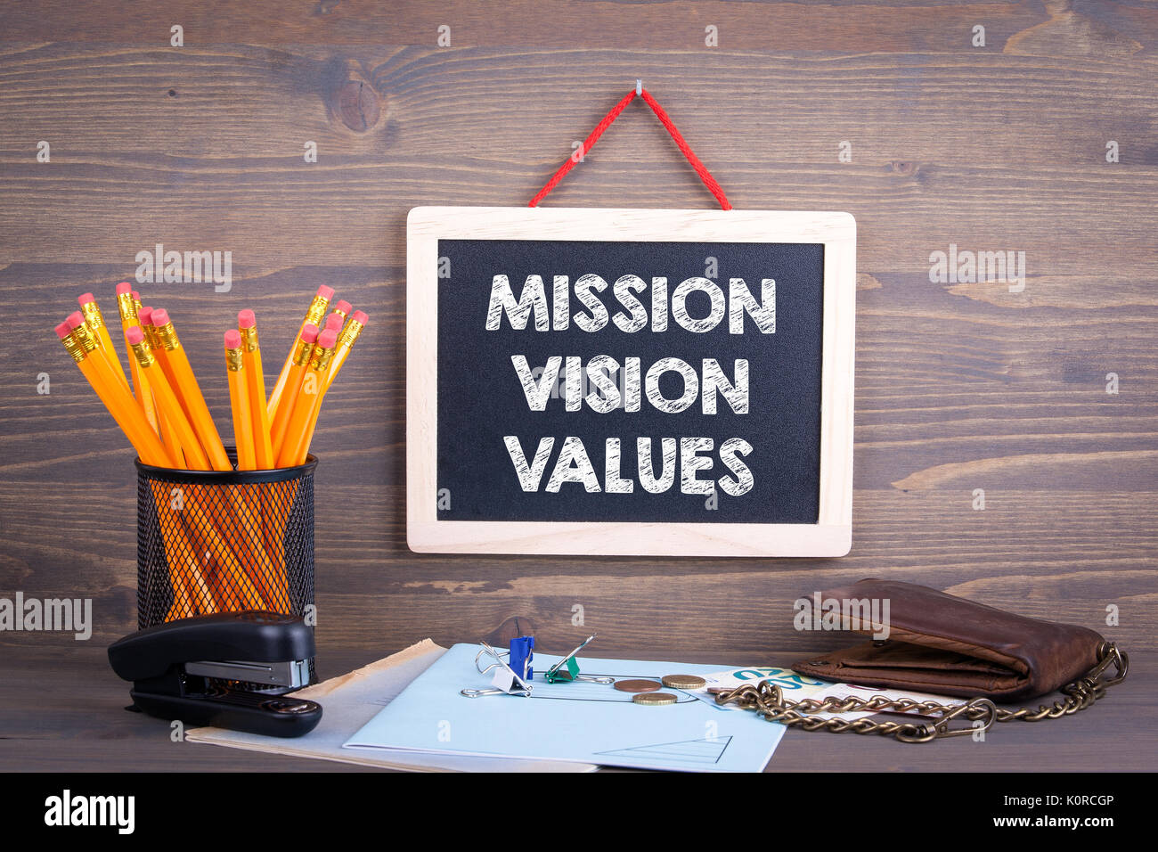 Mission, Vision and Values. Chalkboard on a wooden background. - Stock Image