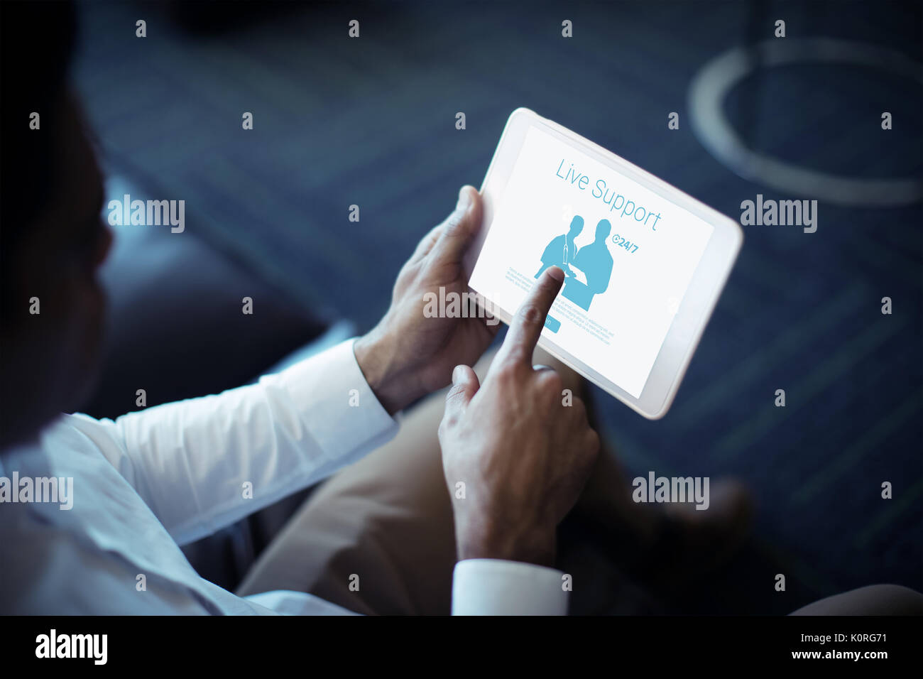Live support text with human representations against cropped image of businessman using tablet Stock Photo