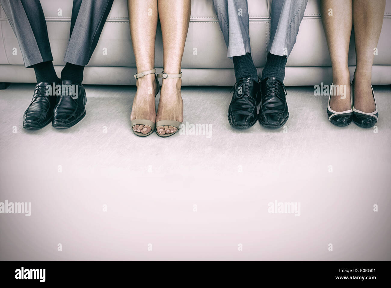 Low section of business people waiting for job interview Stock Photo