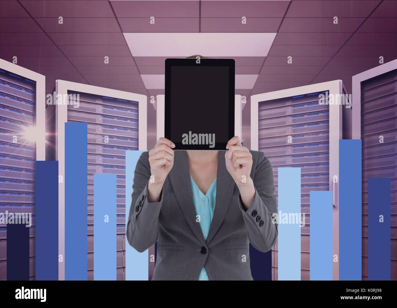 Digital composite of Business woman holding a tablet and graphics in server room - Stock Image