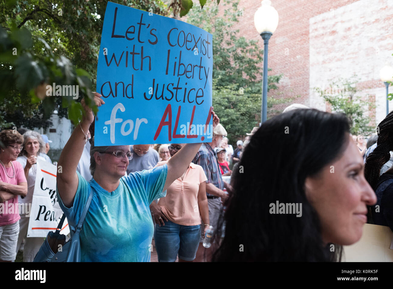 Residents of a small town in lower Hudson Valley in New York State protest against President Trumps  and the racial tensions in Charlottesville - Stock Image