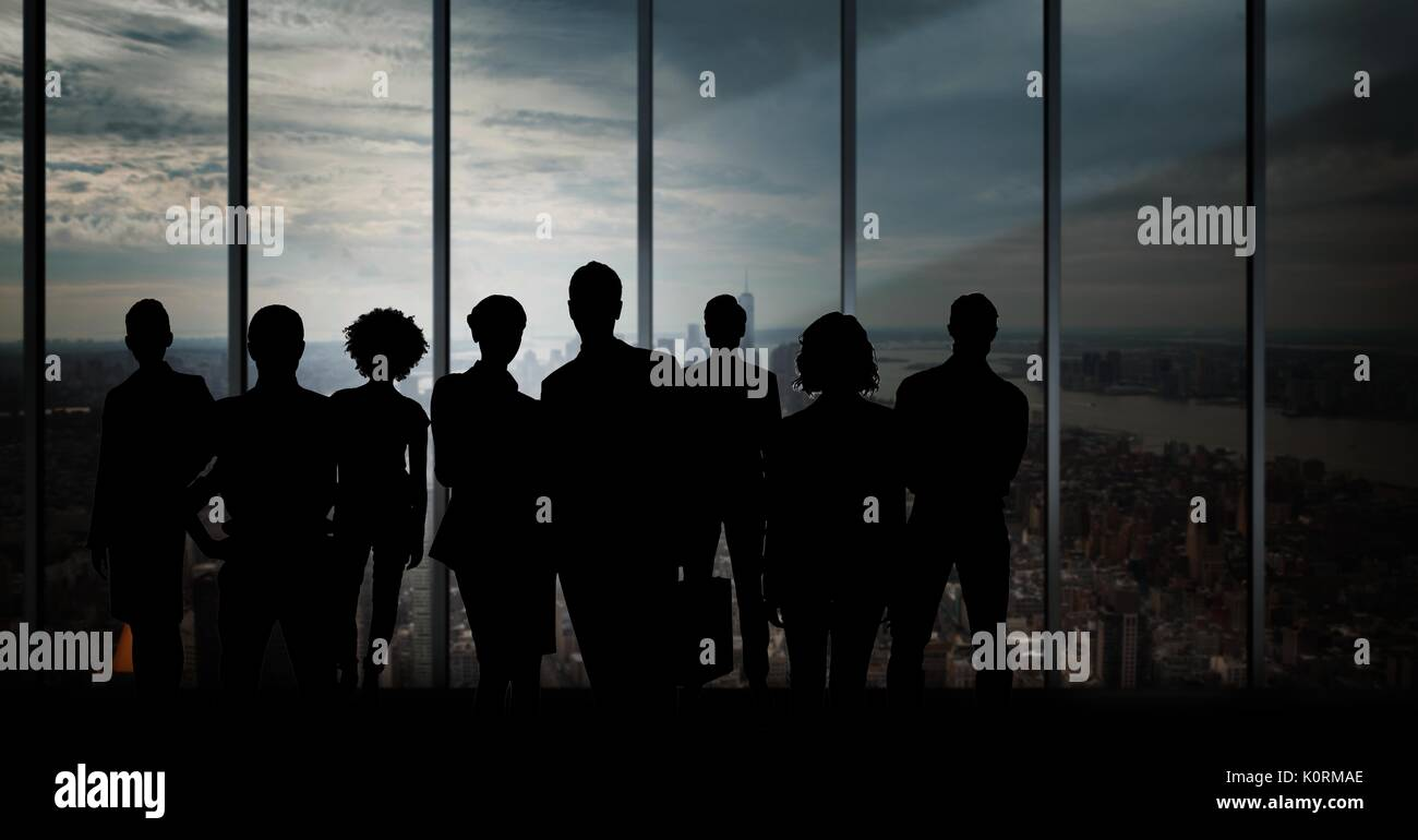 Digital composite of Business people silhouettes against building - Stock Image