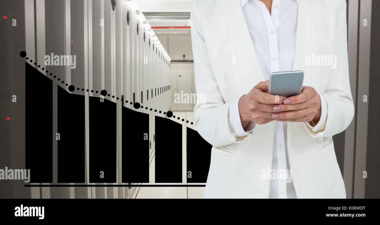 Digital composite of Business woman holding a phone and graphics in server room - Stock Image