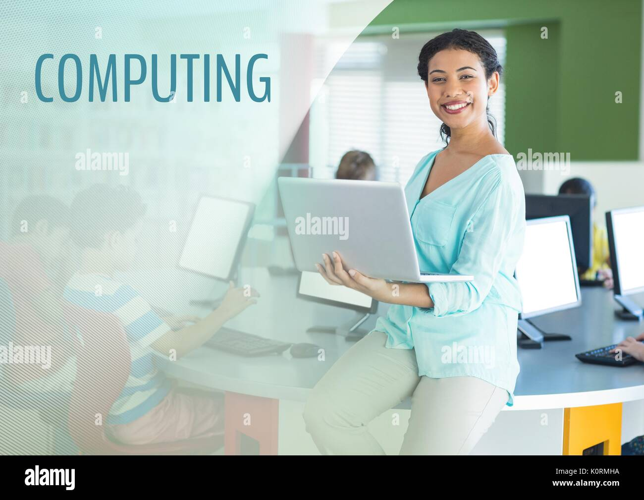 Digital composite of Computing text and Teacher with class in computer room - Stock Image