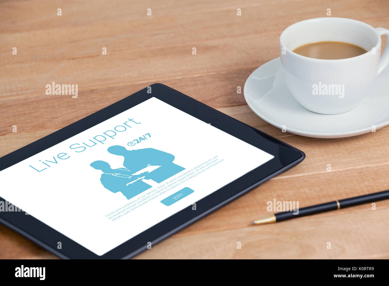Live support text with human representations against digital tablet with pen and cup of tea Stock Photo