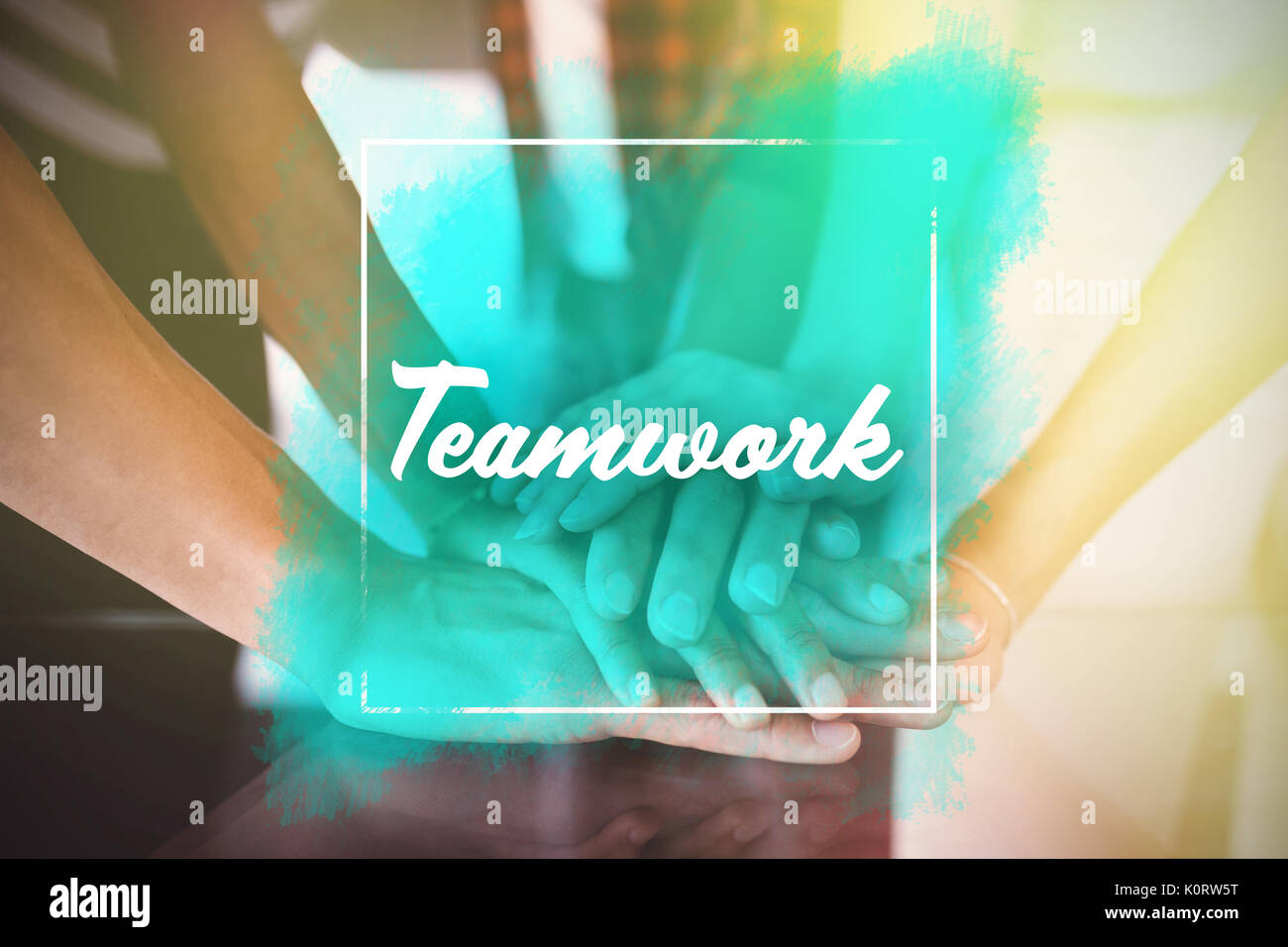Teamwork text message against business people stacking hands