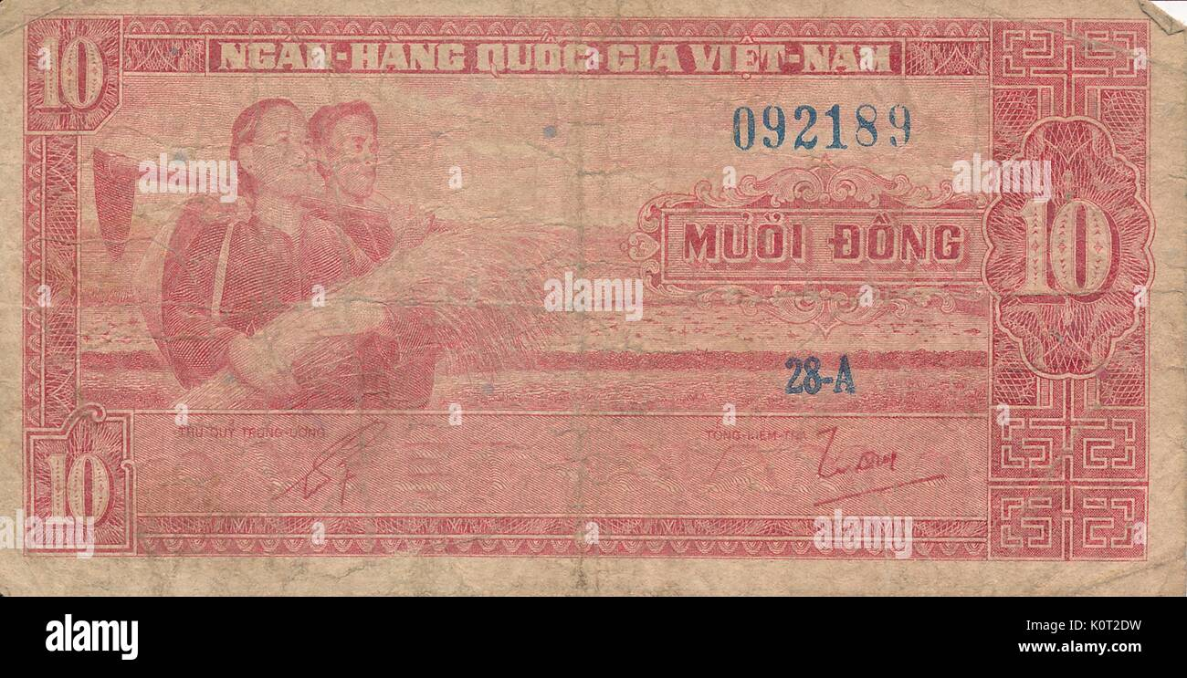 10 dong note, a Vietnamese currency note issued during the Vietnam War, red and white color, with faded image of two people standing proudly with a sheaf of wheat, 1964. - Stock Image