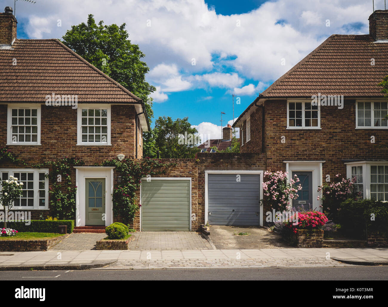 Typical semi-detached houses in North London (UK). July 2017. Landscape format. - Stock Image