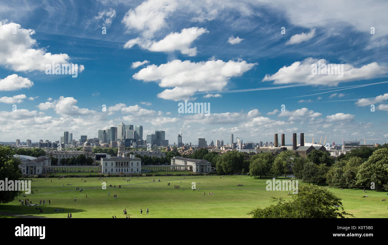 View of Canary Wharf and the Maritime Museum from Greenwich Park in London (UK) - Stock Image