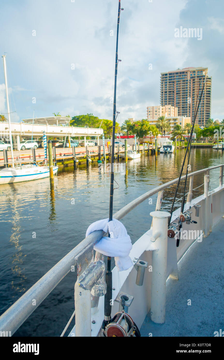 FORT LAUDERDALE, USA - JULY 11, 2017: Three big game fishing rods in a big boats parked in the water in the pier Stock Photo