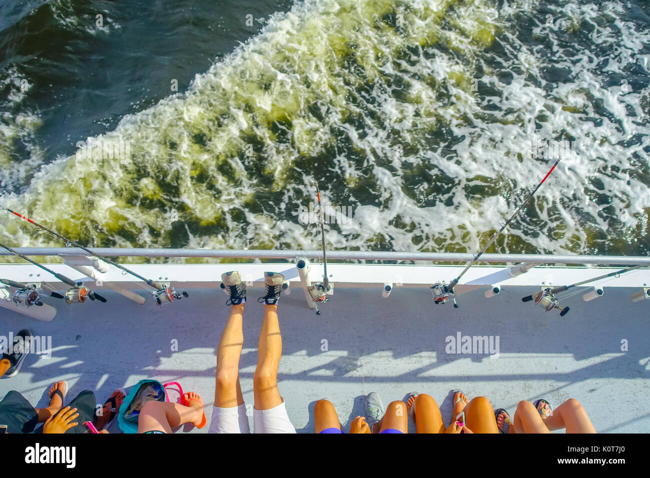 FORT LAUDERDALE, USA - JULY 11, 2017: Aerial view of unidentified people in front of a fishing rods in a big boat Stock Photo