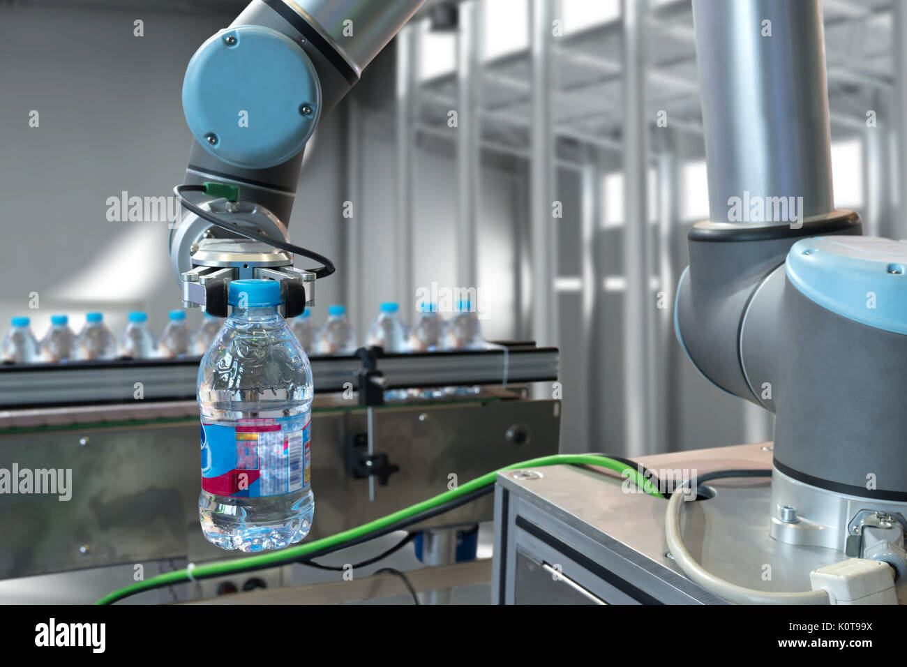 1afaada30f Automatic manufacturing production machine , robot gripper warehouse  picking holding water bottle in smart factory.