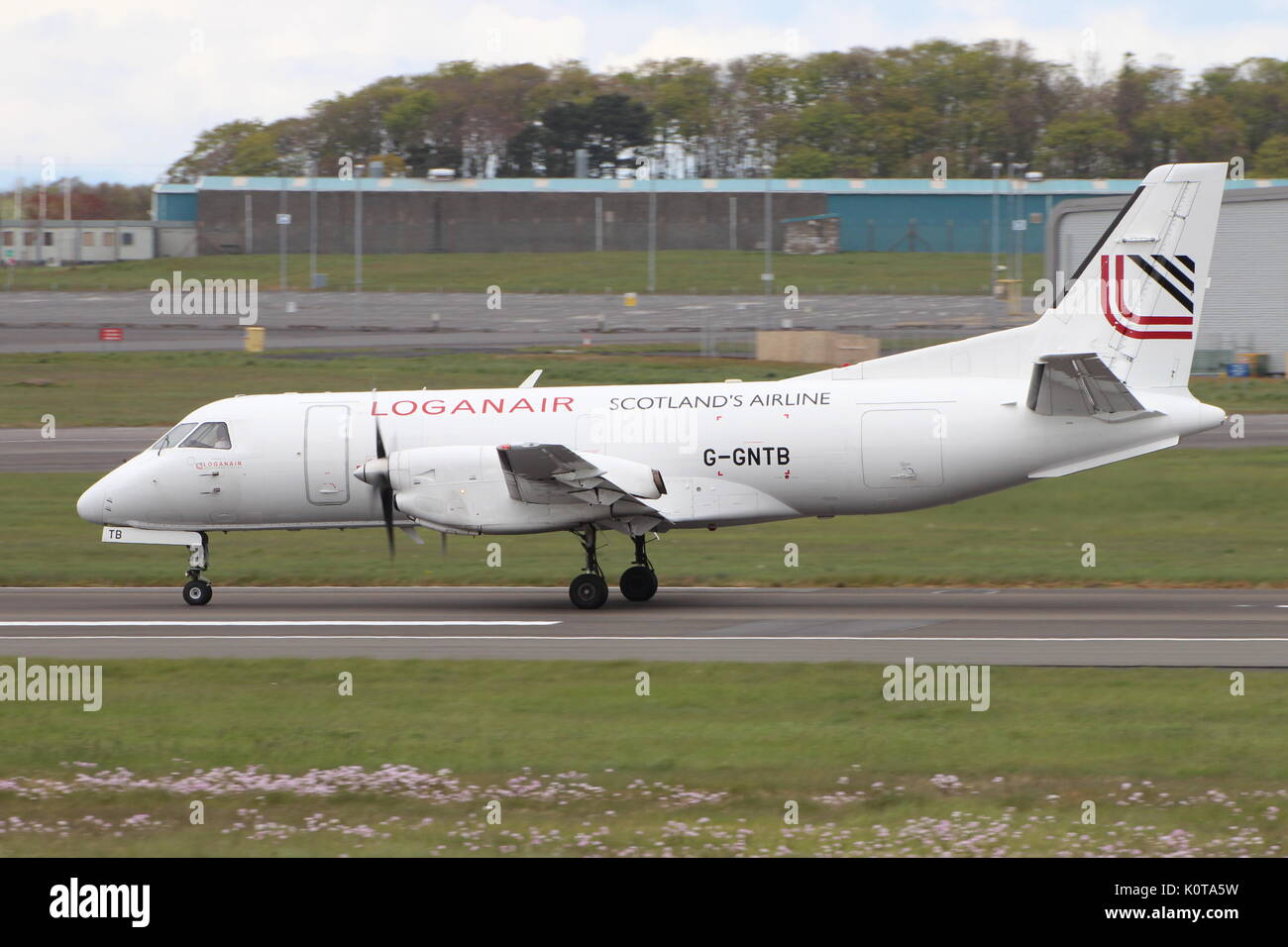 G-GNTB, a Saab 340 operated by Loganair, during training at Glasgow Prestwick International Airport in Ayrshire. Stock Photo