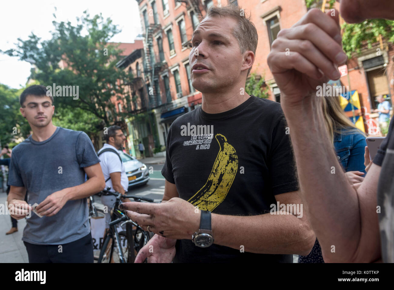 """New York, USA. 23rd Aug, 2017. American Artist Shepard Fairy discusses his work with fans and passersby after creating his newest mural of Blondie in the East Village. The mural features Debbie Harry, lead singer for the rock group Blondie, who got their start in 1979 at CBGB which was located across the street. Fairy's work is also featured in Blondie's latest album """"Polinator"""" which was released in May 2017 Credit: Stacy Walsh Rosenstock/Alamy Live News - Stock Image"""