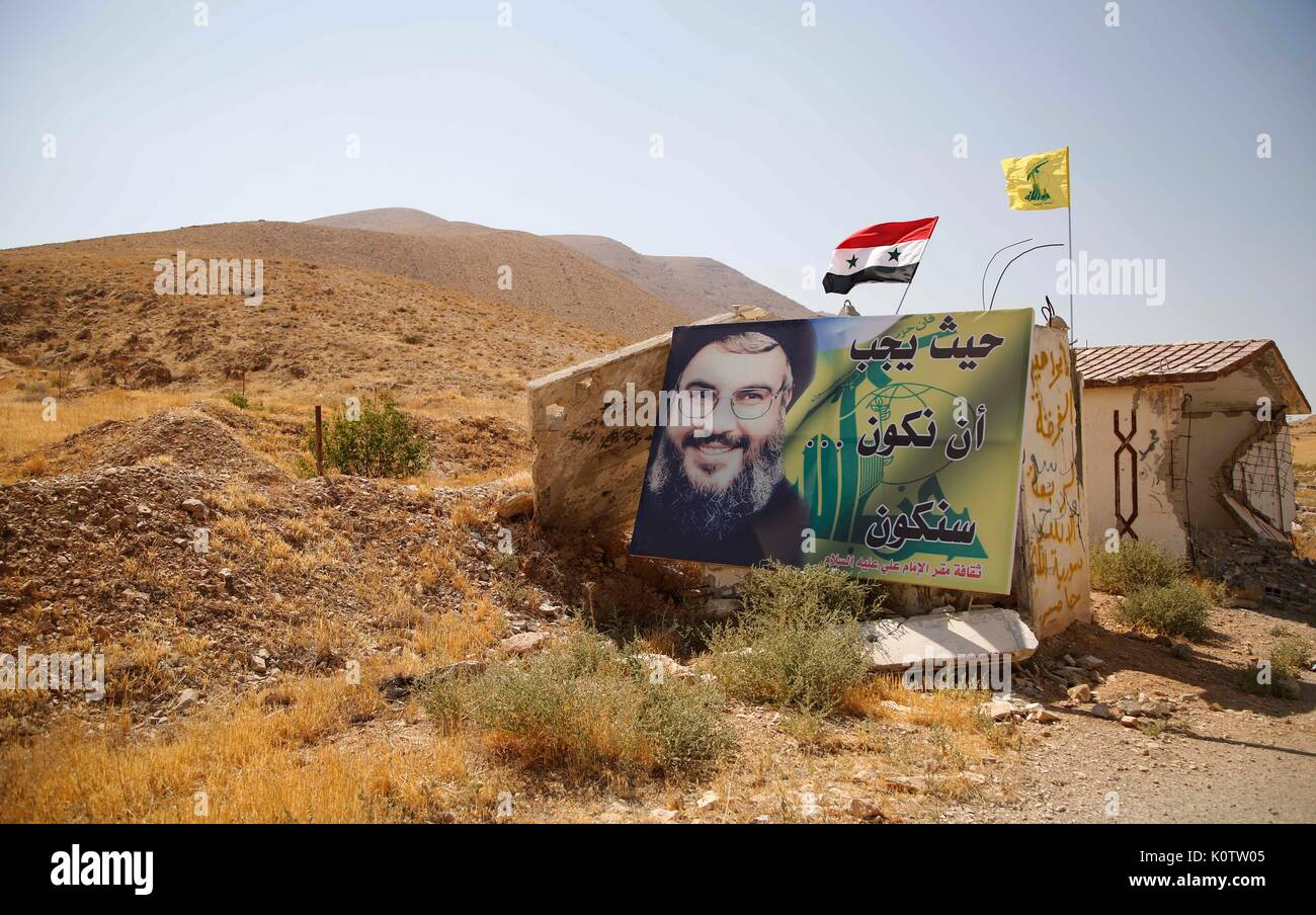 (170823) -- QARA(SYRIA), Aug.23 (Xinhua) -- A giant poster of Hezbollah leader sheikh Hassan Nasrallah, with one of his famous statements 'we will be whenever we have to be,' is seen in Qara town, western Qalamoun region, Syria, on Aug. 23, 2017. The Lebanese Hezbollah group and Syrian army are dealing heavy blow to the Islamic State (IS) group in Syria's Qalamoun region near Lebanon to end the presence of the terror-designated group in the border region between both countries. (Xinhua/Ammar Safarjalani) - Stock Image