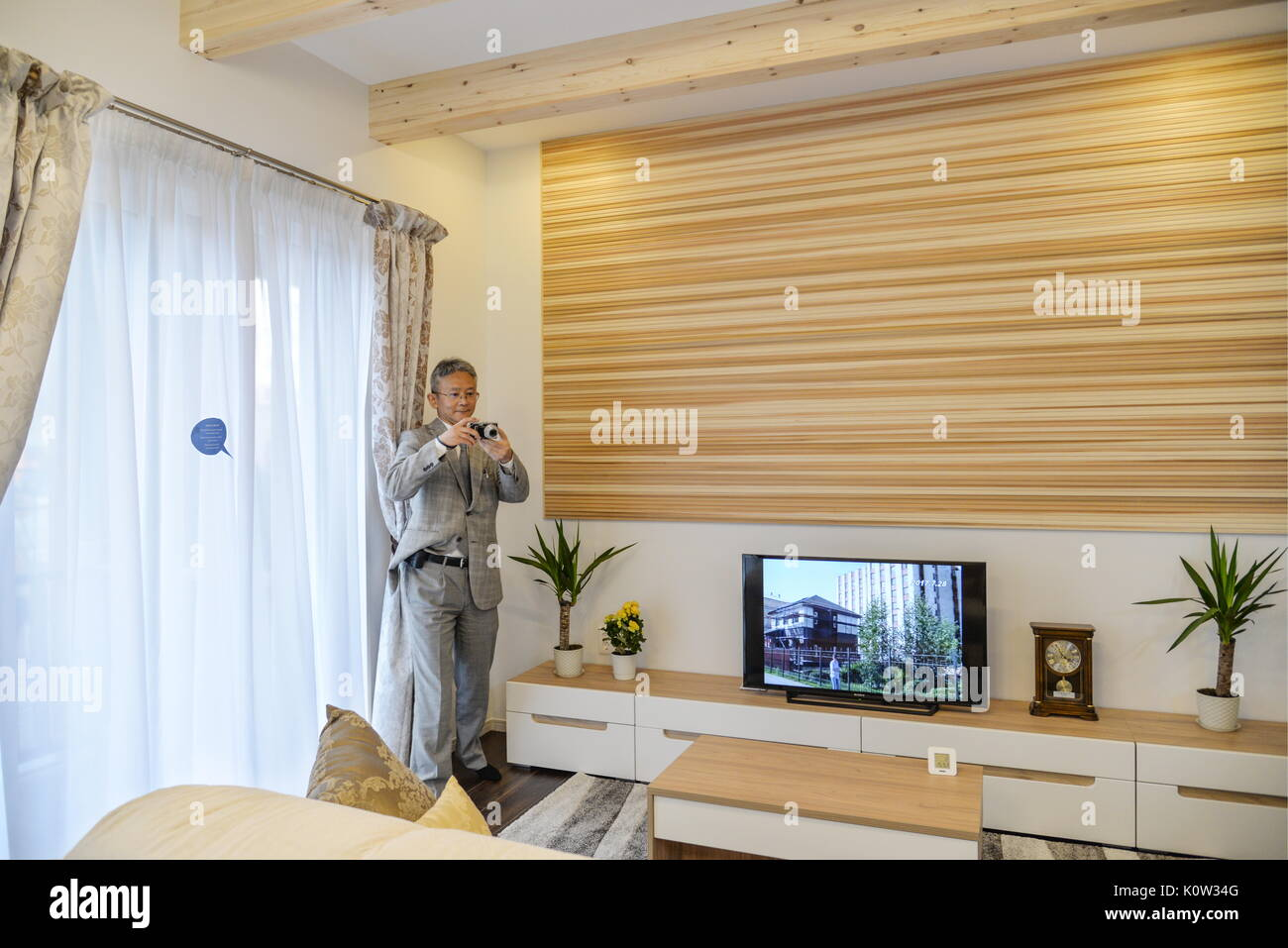 VORONEZH, RUSSIA - AUGUST 24, 2017: The living room of the first Russian-Japanese two-storey smart home made of wood and eco-friendly materials. The house is equipped with energy management system, air quality monitors and temperature sensors. Kristina Brazhnikova/TASS - Stock Image