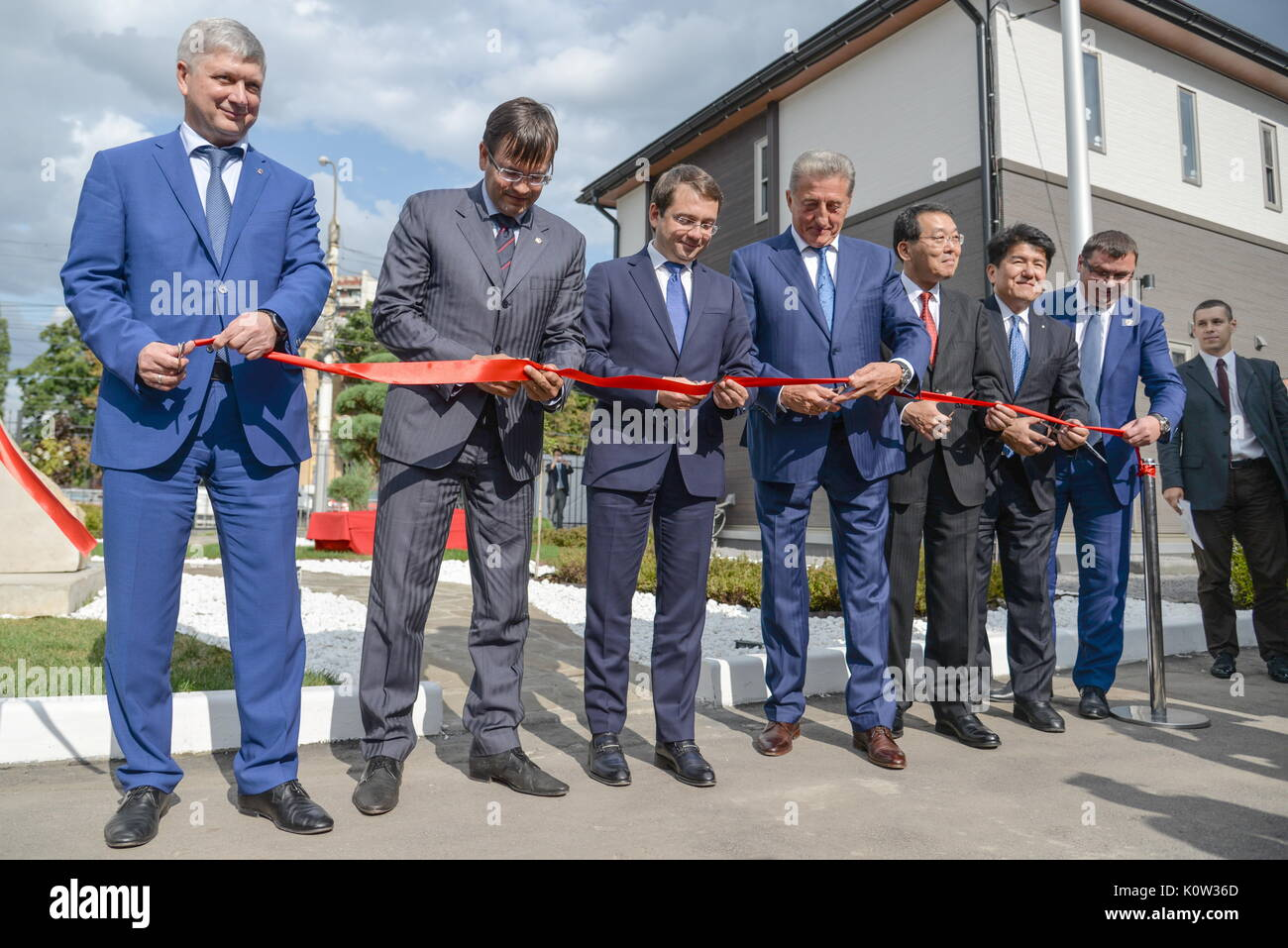 VORONEZH, RUSSIA - AUGUST 24, 2017: Voronezh Mayor Alexander Gusev (L), Russia's Deputy Construction, Housing and Utilities Minister Andrei Chibis (3rd L), Japan's Deputy Land, Infrastructure, Transport and Tourism Minister Koichi Yoshida (4th R), Nice Holdings, Inc. President and Representative Director Kiyoshi Higurashi (3rd R), and Voronezh State Technical University Rector Sergei Kolodyazhny (2nd R) at the opening of the first Russian-Japanese two-storey smart home made of wood and eco-friendly materials. The house is equipped with energy management system, air quality monitors and tempera - Stock Image